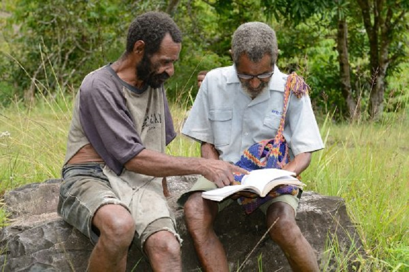 two men reading the Bible together