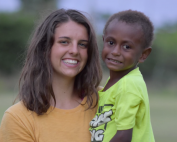Interface student holding a Papua New Guinean boy
