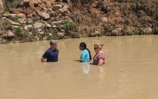 two missionaries are baptizing a Nahuatl believer