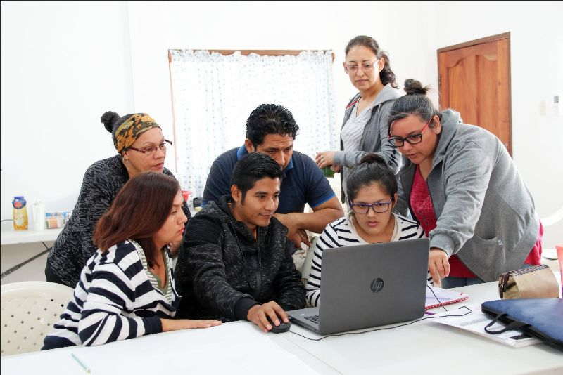Jenny (right), Silvana (top) and other missionaries attend a literacy workshop