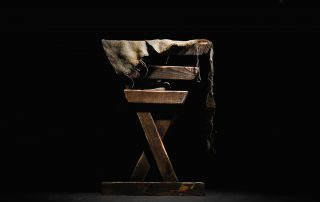 wooden manger with ratty cloth draped over it