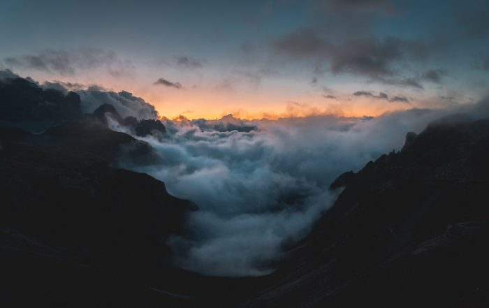 a cloud choked valley in Italy