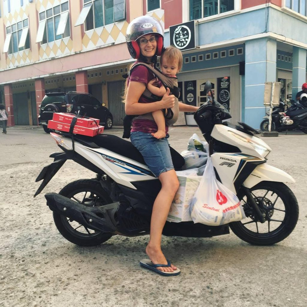 Lauren Ducommun, Ethnos Canada missionary on motorcycle in Asia
