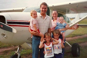 Vern and Holly Dyck with their kids by an airplane