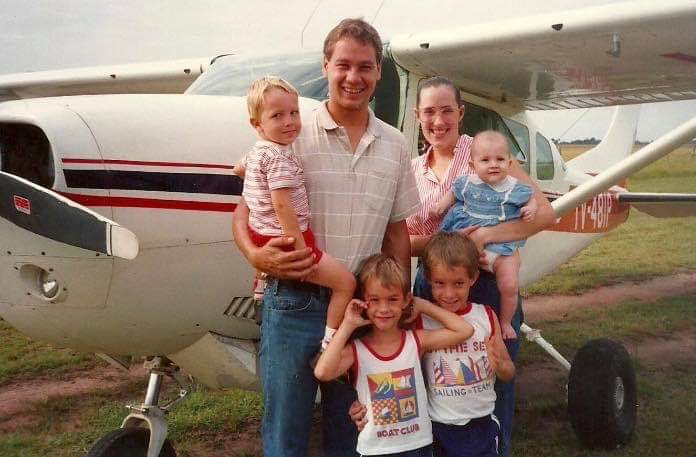 Vern and Holly Dyck with their kids by a small bush-plane