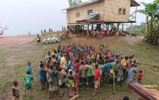 Kovol people gathering for the helicopter flight