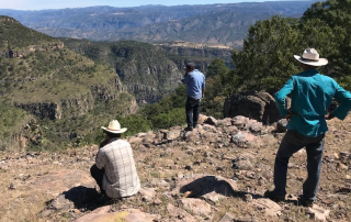 Nahuatl men looking at the mountainous horizon