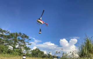 helicopter carrying sling-loaded goods