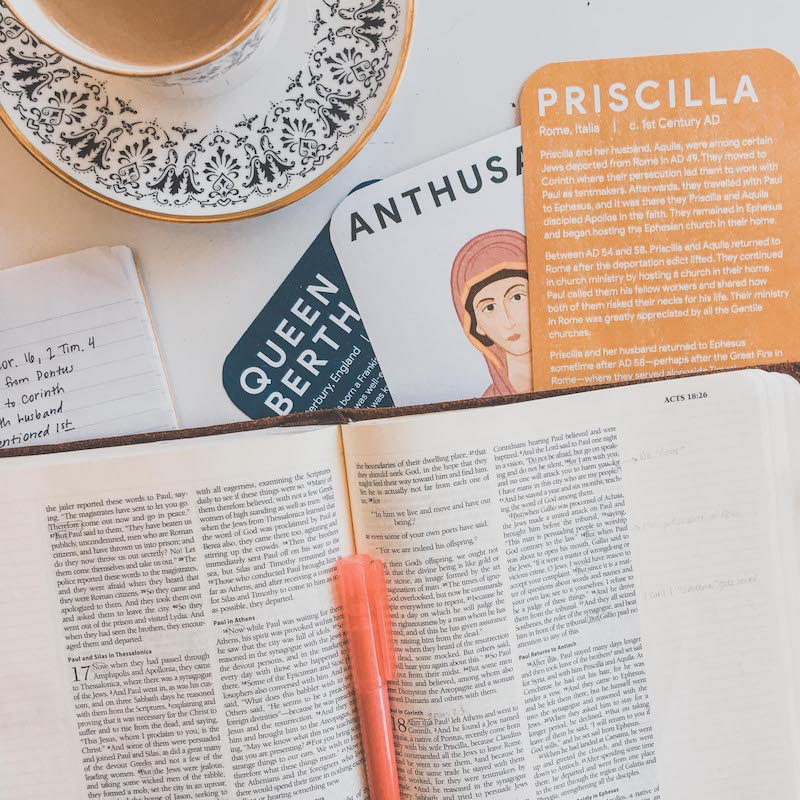 cards with Bible and hot drink
