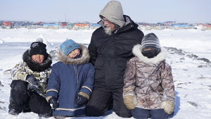Inuit man with children