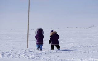 two kids walking outside in the far north