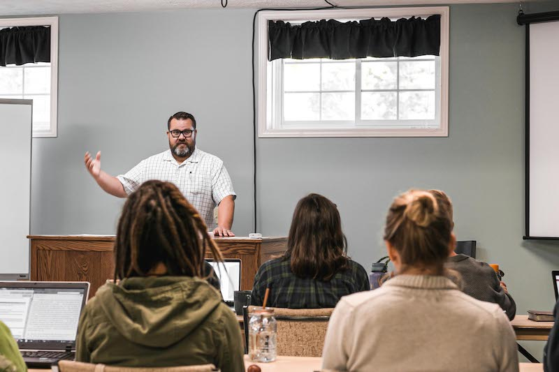 Ethnos Canada missionary, Matt Gunther teaching new missionaries in a classroom
