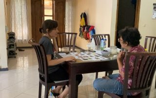 missionary studying language with language helper