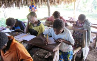 young Mengen people learning how to read and right their own language