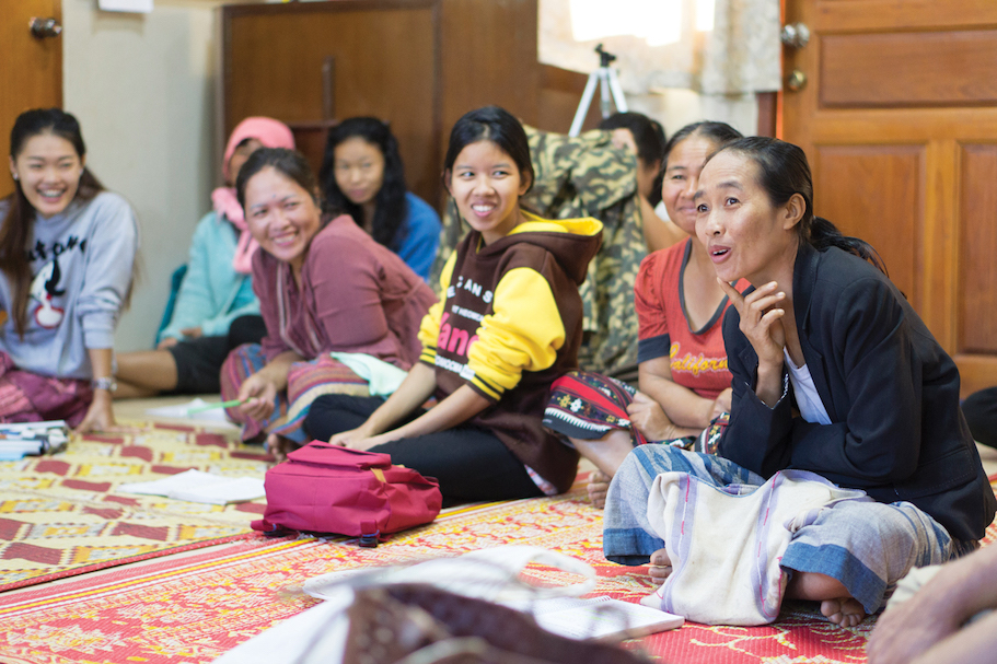 SE Asian women discussing at a Bible study