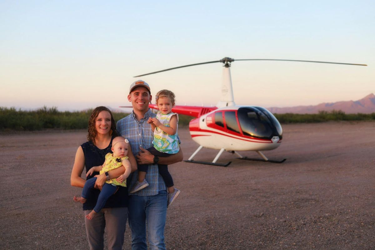 de Roos family in front of a helicopter