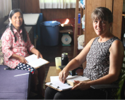 women translating the Bible together
