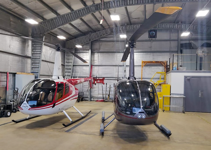 two r66 helicopters