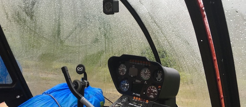 fogged up helicopter canopy in the rain