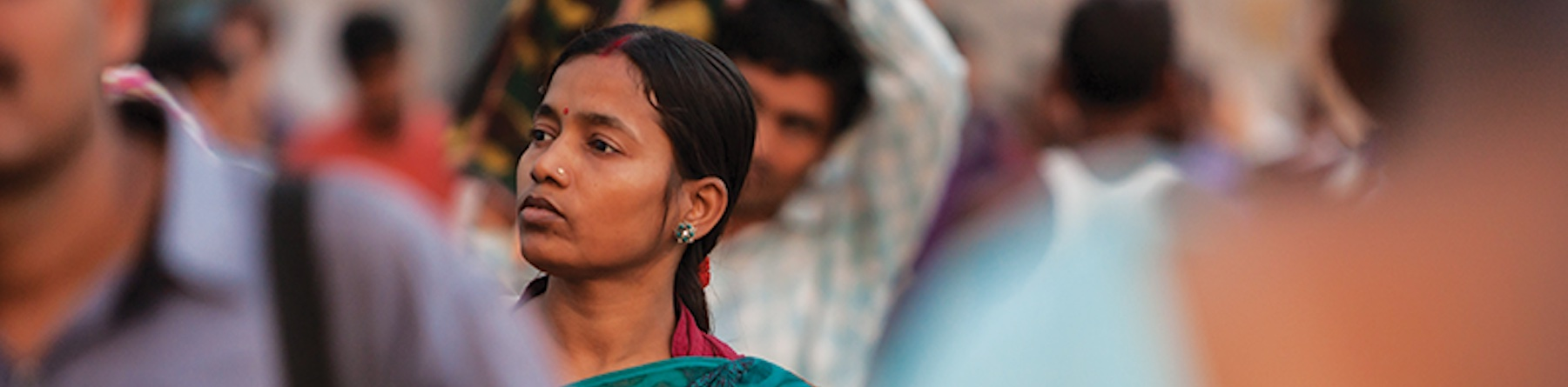 woman in a South Asia crowd